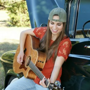 Marcy Grace playing guitar